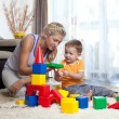 Cute mother and child boy playing together indoor — Stock Photo #12111592
