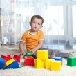 Child playing with building blocks at home. — Stock Photo #12111612