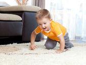 Cute cheerful crawling boy — Stock Photo