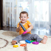 Child playing with toy at home. — Stock Photo