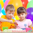 Kids boy and girl eating cake on party birthday — Stock Photo