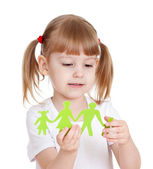 Little girl holding and showing on family cutting from paper — Stock Photo