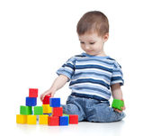 Cheerful kid boy with construction set over white background — Stock Photo