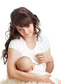 Young mother breast feeding her infant — Stock Photo