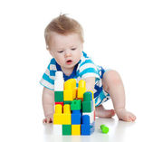 Cheerful child boy playing with construction set over white back — Stock Photo