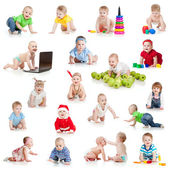 Set of crawling babies or toddlers with toys isolated on white — Stock Photo