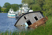 Drifting barge on river — Stock Photo