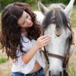 Talking to her horse — Stock Photo