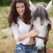Stock Photo: Woman and horse friendship