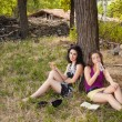 Girl friends in the woods — Stock Photo