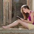 Reading on a porch — Stock Photo