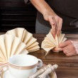 Folding napkins for lunch - Stockfoto