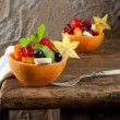 Fruit salad on antique table — Stock Photo