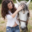Stock Photo: Caring for horse