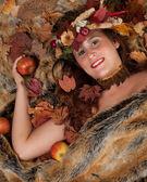 Autumn woman on fur blanket — Stock Photo