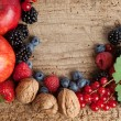 Thanksgiving fruit border on a board — Stock Photo