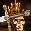 Sword and skull — Stock Photo