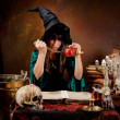 Witch with poison apple — Stock Photo #12385118