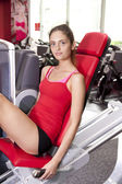 Young woman at gym — Stock Photo
