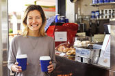 Smiling woman with coffee — Stock Photo