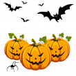 Halloween pumkins and bats — Stock Vector