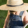Royalty-Free Stock Photo: A boy with straw hat, a young gardener enjoying the spring