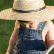 A boy with straw hat, a young gardener enjoying the spring — Stock Photo #11303339