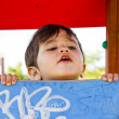 Baby playing in a playground — Stock Photo