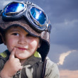 Adorable baby dressed in pilot uniform with funny face — Stock Photo #11303387