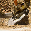 Excavator digging a deep trench — Stock Photo #11304276