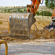 Construction site with excavating equipment — Stock Photo