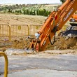 Construction site with excavating equipment - Stock Photo