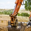 Excavator loader machine during earthmoving works outdoors at co - Stock Photo