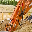 Excavator loader machine during earthmoving works outdoors at co — Stock Photo