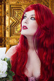 The beautiful young woman red haired in mysterious medieval room — Stock Photo