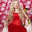 Flower queen in a red dress — Stock Photo