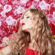 Stock Photo: Flower queen in a red dress