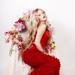 Flower queen in a red dress — Stock Photo #10824025