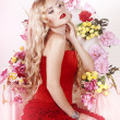 Flower queen in a red dress — Stock Photo #10824144