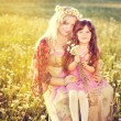 Mother with daugher on the meadow — Stock Photo #11008058