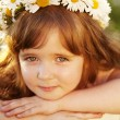 Lovely little baby girl with daisy wreath on her head — Stock Photo