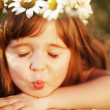Lovely little baby girl with daisy wreath on her head — Stock Photo #11008125