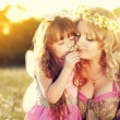 Mother with daugher on the meadow — Stock Photo