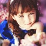 Girl holding flowers — Stock Photo #11396840
