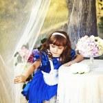 Girl holding flowers — Stock Photo #11396863