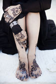 Details shot of henna tattoos on Indian bride — Stock Photo