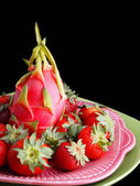 Dragon Fruit and Strawberries on Black — Stock Photo