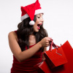 Beautiful brunette girl holding christmas shopping bags — Stock Photo
