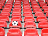 Football on stadium chairs — Stock Photo