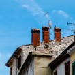 Three Red Chimneys on Roof in Porec, Croatia — Stock Photo